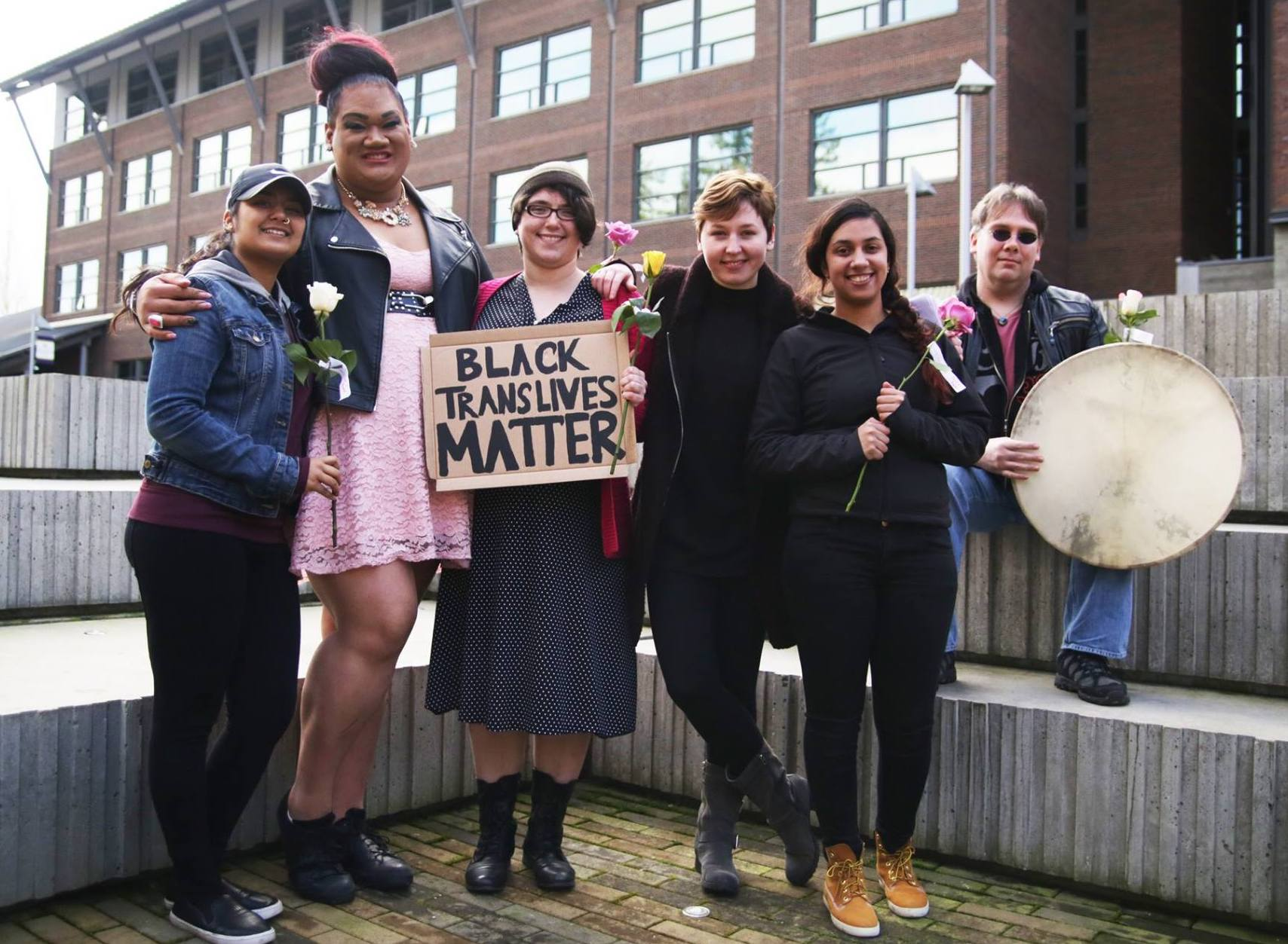 Six people outside with a sign that says Black trans lives matter